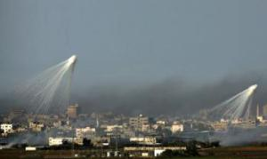 Israel is believed to be using controversial white phosphorus shells to screen its assault on the heavily populated Gaza Strip yesterday. As the Israeli army stormed to the edges of Gaza City and the Palestinian death toll topped 500, the tell-tale shells could be seen spreading tentacles of thick white smoke to cover the troops' advance. (Patrick Baz/AFP/Getty Images)